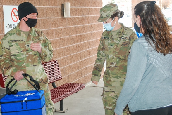 U.S. Army Spc. Drake Pugaczewski and Sgt. Kelsie McCallum deliver the COVID-19 vaccine to the Delta County Memorial Hospital, Delta, Colorado, Dec. 16, 2020. The CONG is implementing the state's vaccination plan by transporting the vaccine to storage locations around the state and to medical care facilities administering the vaccine. (Photo courtesy Delta County Memorial Hospital)