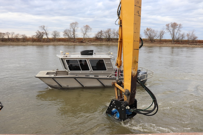 A Kansas City District work boat performs river bottom surveys while taking part in hydrodynamic dredging operations on the Missouri River November 11, 2020. The Engineering Research and Development Center brought the system to Kansas City District from Vicksburg, Miss., to assist in clearing shoals that developed on the Missouri River due to damages from flooding to the river control structures. The device enabled the combined team to redirect sandy material back into suspension in the current of the river and away from the built-up areas that impede navigation on the river.