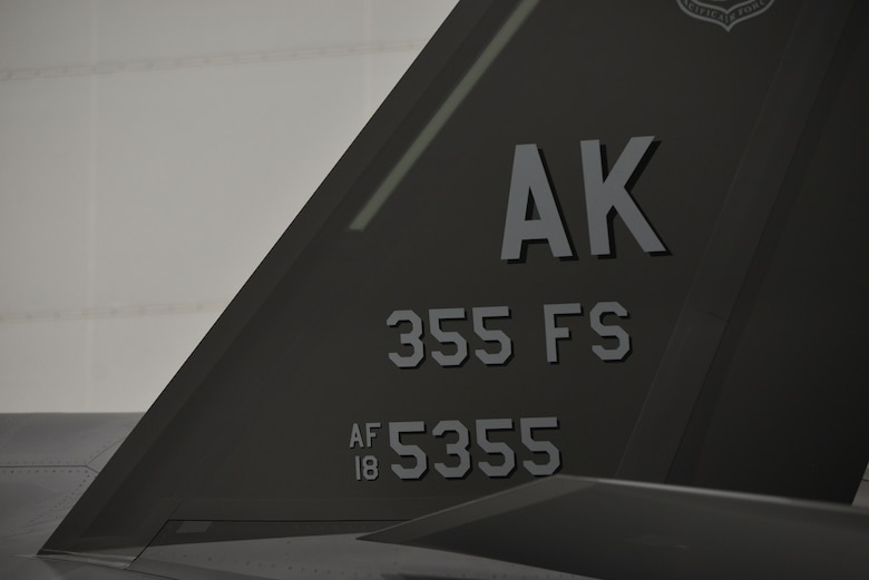 The 355th Fighter Squadron flagship F-35A Lightning II aircraft is parked in a hangar during the squadron reactivation ceremony at Eielson Air Force Base, Alaska, Dec. 18, 2020.