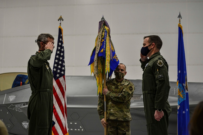 U.S. Air Force Lt. Col. Samuel Chipman renders a salute to Col. David Skalicky, the 354th Operations Group commander, during the 355th Fighter Squadron reactivation ceremony Dec. 18, 2020, at Eielson Air Force Base, Alaska