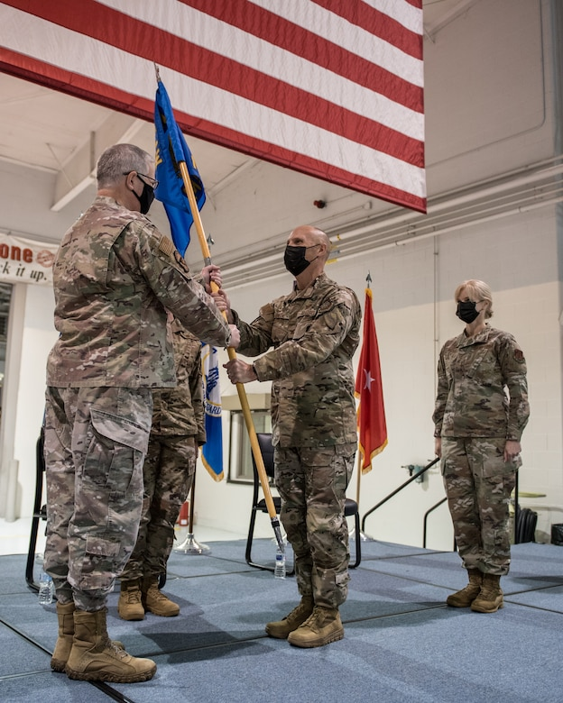 Col. George H. Imorde III (center), incoming commander of the 123rd Mission Support Group, receives the group's guidon from Col. David Mounkes (left), commander of the 123rd Airlift Wing, during a change-of-command ceremony at the Kentucky Air National Guard Base in Louisville, Ky., on Nov. 14, 2020. Imorde previously served as the 123rd Security Forces Squadron commander and antiterrorism officer for the 123rd Airlift Wing. (U.S. Air National Guard photo by Staff Sgt. Joshua Horton)