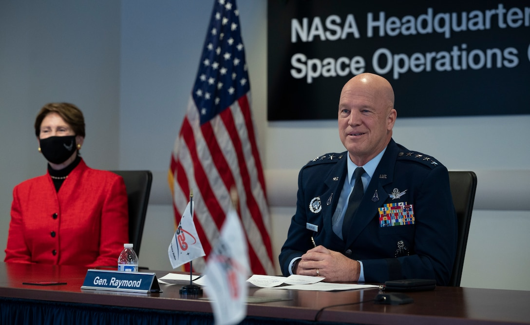 General John Raymond, Chief of Space Operations, U.S. Space Force, right, and Secretary of the Air Force Barbara Barrett left, are seen during a transfer ceremony, Friday, Dec. 18, 2020, from the Space Operations Center at NASA Headquarters in Washington.