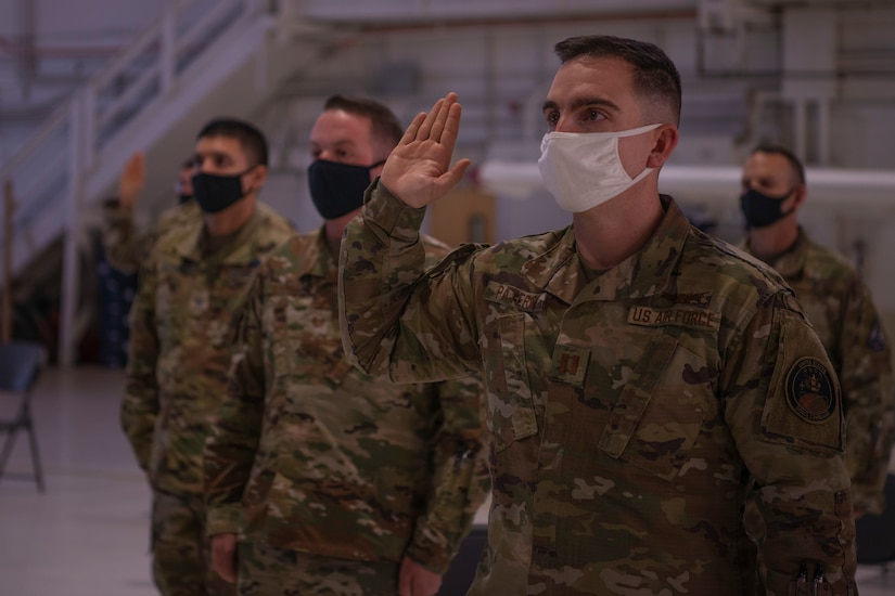Masked airmen swear oath to the Space Force.