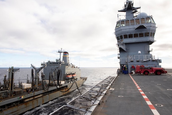 USNS Laramie (T-AO 203) completes a refueling-at-sea with Mistral-class LHD Dixmude (L9015) in the Atlantic Ocean, Dec. 10.