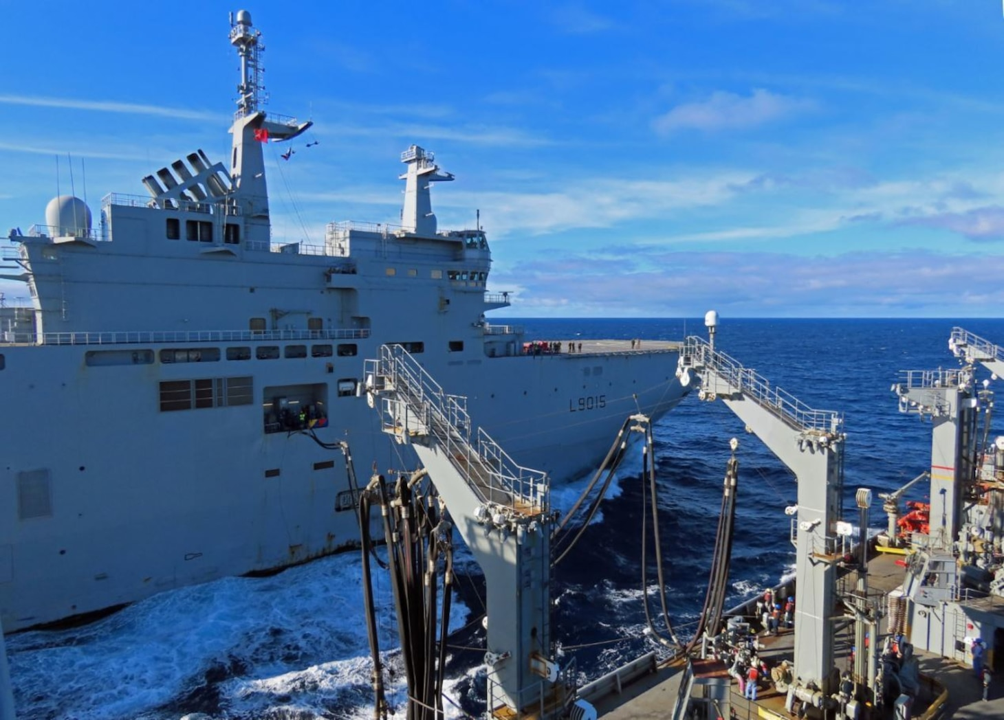 USNS Laramie (T-AO 203) completes a refueling-at-sea with French Navy LHD Dixmude (L9015) in the Atlantic Ocean, Dec. 10.
