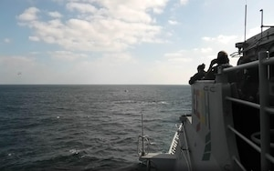 The guided-missile cruiser USS Port Royal (CG 73), deployed to U.S. Fifth Fleet and operating in direct support to Combined Maritime Forces (CMF) CTF-150, observe as a visit, board, search and seize (VBSS) team interdicts a dhow suspected of narcotics smuggling in the international waters of the North Arabian Sea, Dec. 18. CMF is a multinational maritime partnership which exists to counter illicit non-state actors on the high seas, promoting security, stability and prosperity in the Arabian Gulf, the Red Sea, Gulf of Aden, Indian Ocean and Gulf of Oman. CTF 150 conducts maritime security operations outside the Arabian Gulf to disrupt criminal and terrorist organizations, ensuring legitimate commercial shipping can transit the region free from non-state threats.