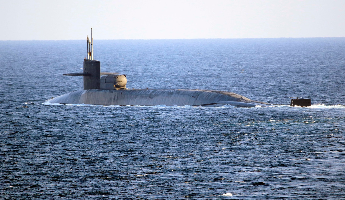 The guided-missile submarine USS Georgia (SSGN 729) transits the Strait of Hormuz, Dec. 21. Georgia is deployed to the U.S. 5th Fleet area of operations in support of naval operations to ensure maritime stability and security in the Central Region, connecting the Mediterranean and Pacific through the Western Indian Ocean and three critical chokepoints to the free flow of global commerce.