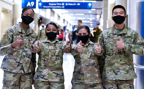 U.S. Army Medical Center of Excellence Soldiers headed to Holiday Block Leave from the San Antonio International Airport demonstrate their enthusiasm for the well-deserved break Dec. 19.