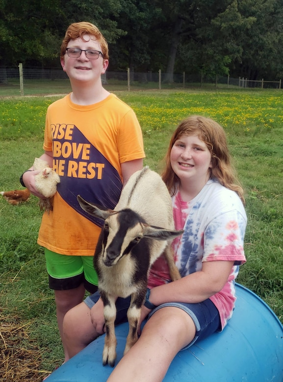 Marcy Releford, an administrative assistant for the Base Operations and Support Branch at Arnold Air Force Base, holds one of the 20 Nigerian dwarf goats she cares for on her 7.5-acre farm in Morrison, Tenn. In addition to goats. Releford also raises bantam Cochin chickens. (Courtesy photo)