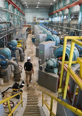 Joshua Cooke, an Arnold Engineering Development Complex senior utility manager, inspects a water pumping station, Sept. 10, 2020, at Arnold Air Force Base, Tenn. The AEDC Base Civil Engineering Branch oversees utilities at Arnold AFB. (U.S. Air Force photo by Jill Pickett)