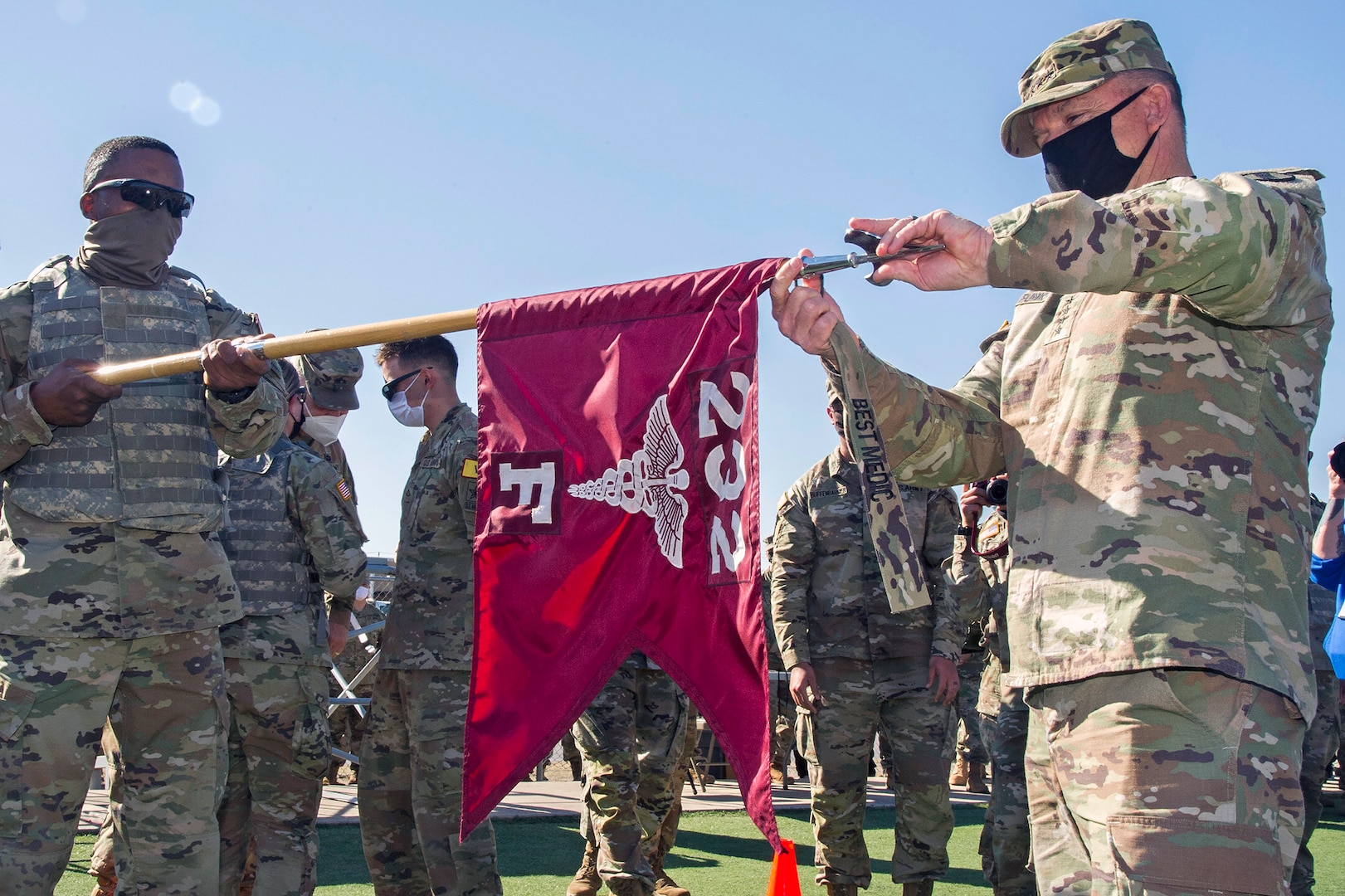 Gen. Paul Funk II, U.S. Army Training and Doctrine commander presents the Best Advanced Individual Training Medic Competition streamer to the winning unit, Company F, 232d Medical Battalion at Joint Base San Antonio-Fort Sam Houston Dec. 17.
