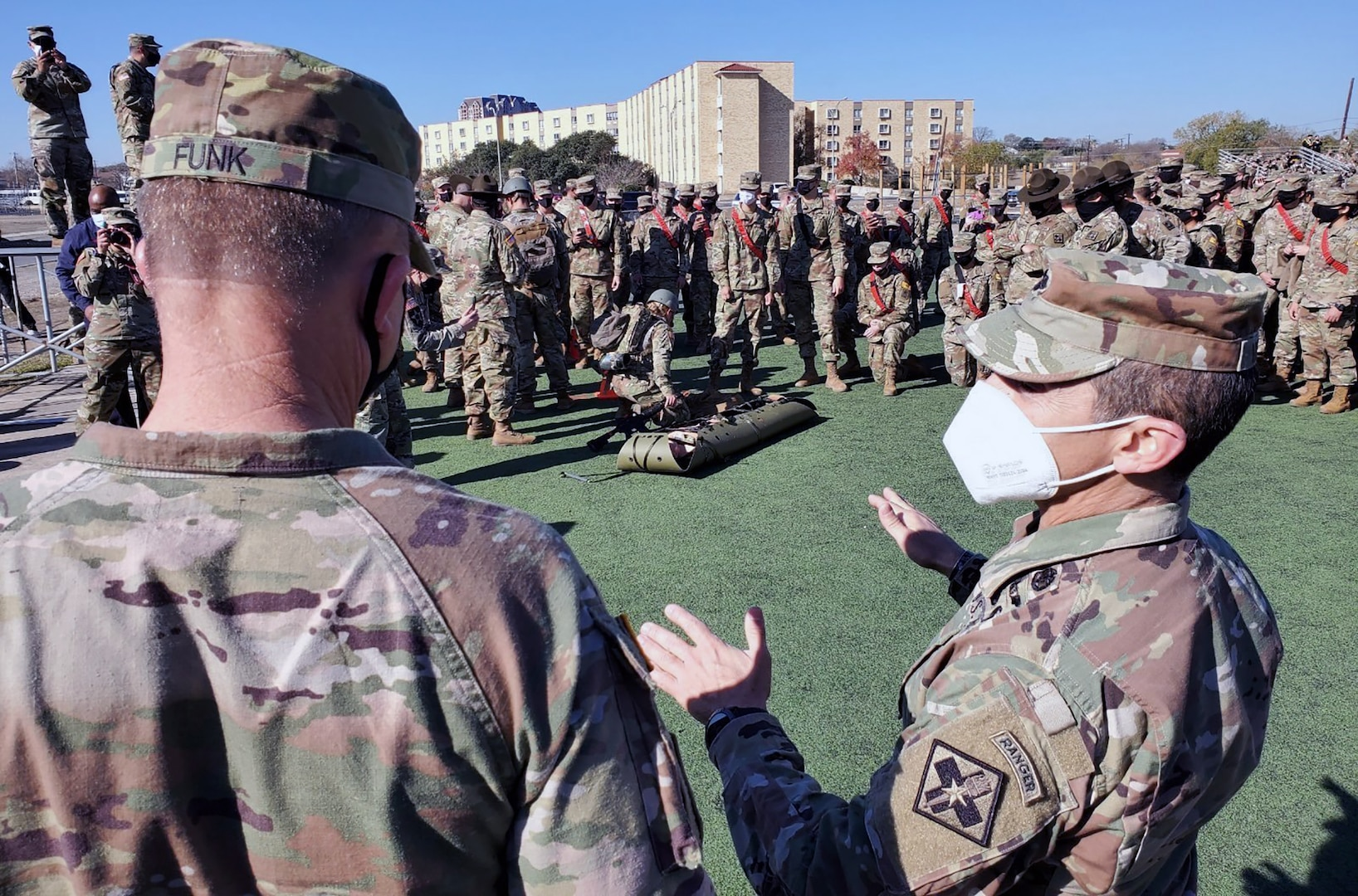 Lt. Col. Manuel Menendez (right), 232nd Medical Battalion Commander, briefs Gen. Paul Funk II (left), U.S. Army Training and Doctrine commander, on the Battalion's Best Advanced Individual Training Medic Competition at Joint Base San Antonio-Fort Sam Houston Dec. 17.