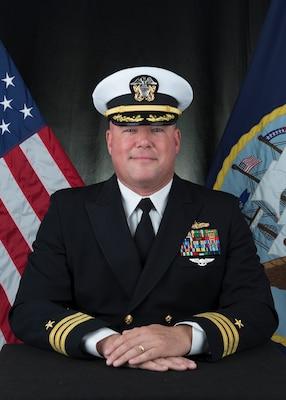 201221-N-N0443-1015 PENSACOLA, Fla. (Dec. 21, 2020) Official photo of Cmdr. Justin Santos. (U.S. Navy photo)
