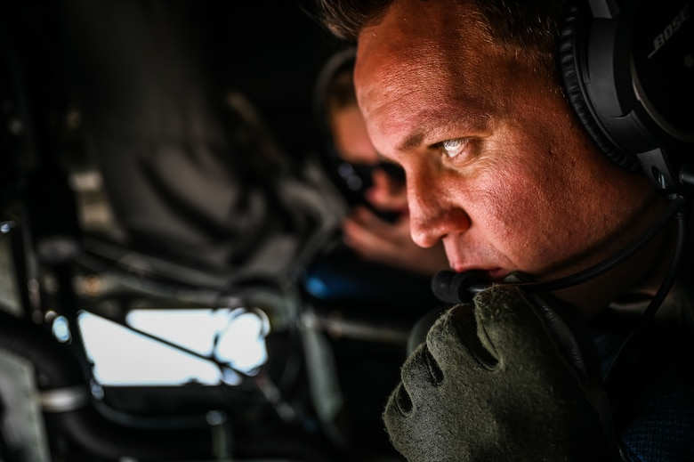 Master Sergeant Dustin Sheldon, a 91st Air Refueling Squadron boom operator, prepares to refuel various formations of fighter aircraft during week-long integrated training at Barksdale Air Force Base, La., Dec. 14, 2020.