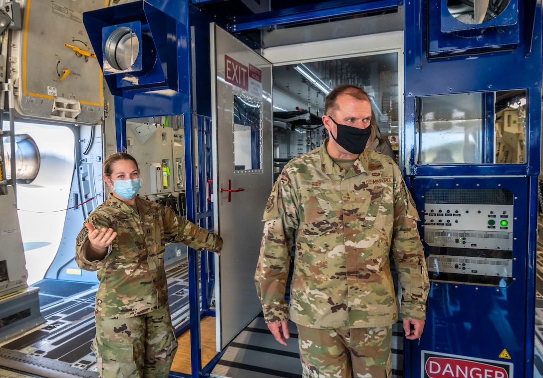 Capt. Alexis Todaro, Negatively Pressurized Conex program manager, briefs Maj. Gen. Thad Bibb, 18th Air Force commander, about the NPC's function during a base visit Sept. 22, 2020, at Dover Air Force Base, Delaware. Bibb, who previously served as the commander of the 9th Airlift Squadron, returned to Dover AFB after ten years to learn about how Dover Airmen contribute to the 18th Air Force mission of warfighter readiness and sustainment. Bibb experienced firsthand Dover AFB's diverse missions and toured new facilities, including the Tactics and Leadership Nexus and Bedrock Innovation Lab. (U.S. Air Force photo by Senior Airman Christopher Quail)
