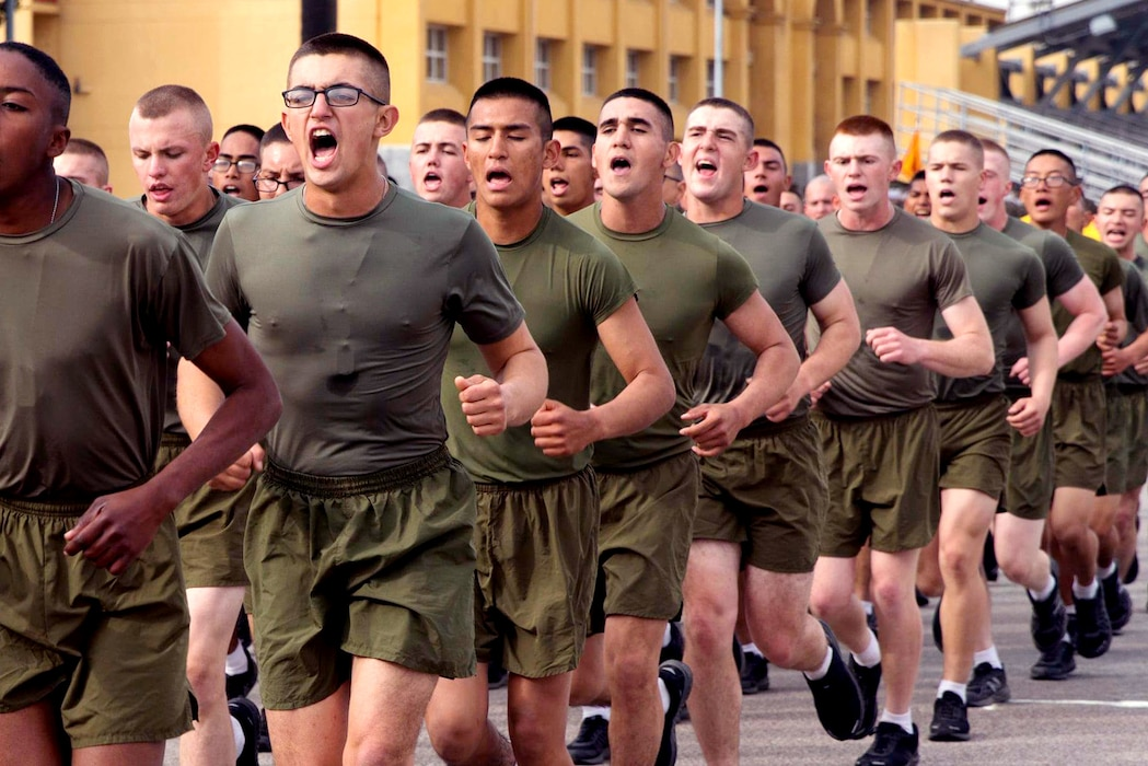 New Marines with Golf Company, 2nd Recruit Training Battalion, participate in a motivational run at Marine Corps Recruit Depot, San Diego, Dec. 17, 2020.