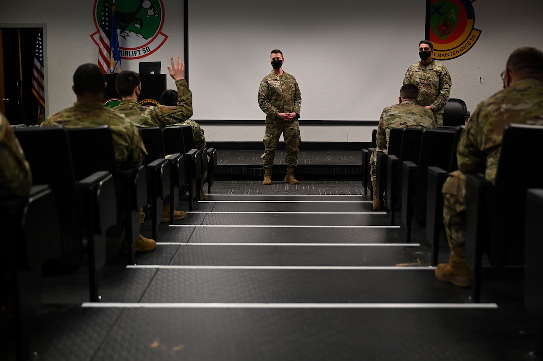 The installation commander speaks with students in an auditorium.