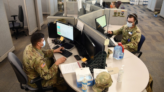 Sometimes, serving the community as a National Guard member means manning the phones. Here, Soldiers with the Arizona Army National Guard assist state health officials with COVID-19 mapping from a call center at the Arizona Department of Health Services in Phoenix, June 30. This kind of mission helped state and local health agencies conduct mapping activities with the aim of tracking and reducing the spread of the coronavirus, which causes COVID-19. (U.S. Air National Guard photo by Tech. Sgt. Michael Matkin)