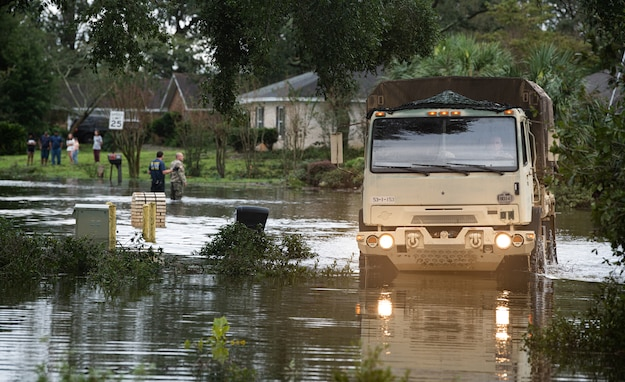 A Florida Army National Guard high water response vehicle makes its way through the flooded roads of Escambia County, Florida, as part of Hurricane Sally recovery efforts Sept. 16. (U.S. Air National Guard photo by Tech. Sgt. Christopher Milbrodt)
