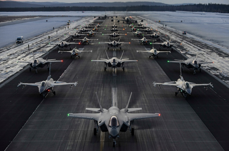 The 354th Fighter Wing and the Air National Guard's 168th Wing aircraft line up in formation on Eielson Air Force Base, Alaska, Dec. 18, 2020.
