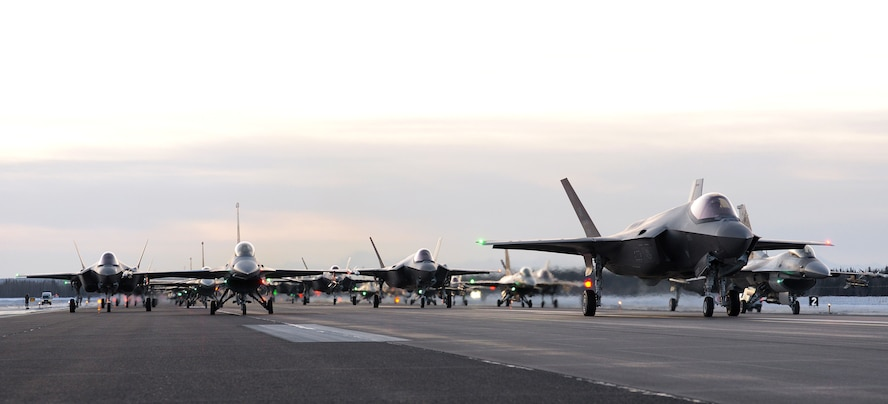 Eighteen U.S. Air Force F-35A Lightning IIs and 12 F-16 Fighting Falcons assigned to the 354th Fighter Wing and two KC-135 Stratotankers assigned to the 168th Wing form an elephant walk on Eielson Air Force Base, Alaska, Dec. 18, 2020.