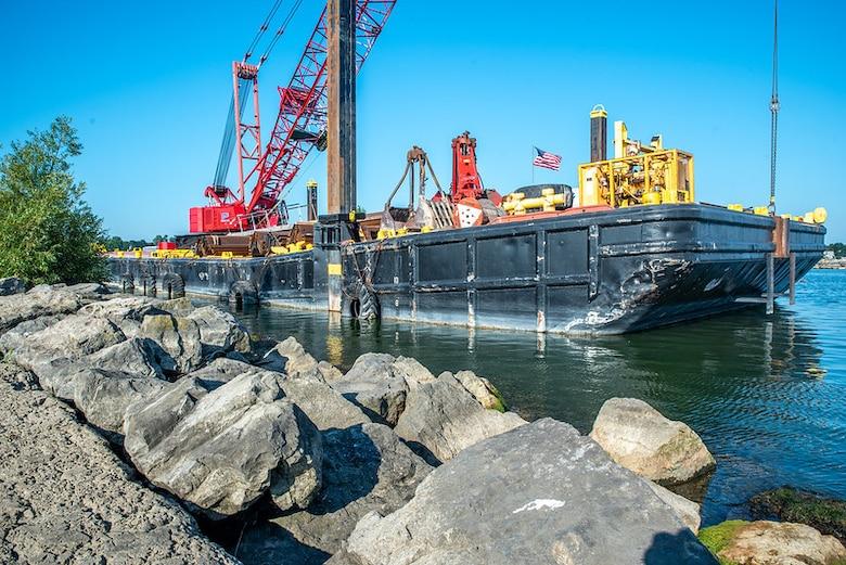 Crews work to repair the Rochester Harbor E. Pier
