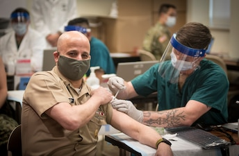 MCPON Russell Smith recieves the COVID-19 Vaccine at Walter Reed National Military Medical Center