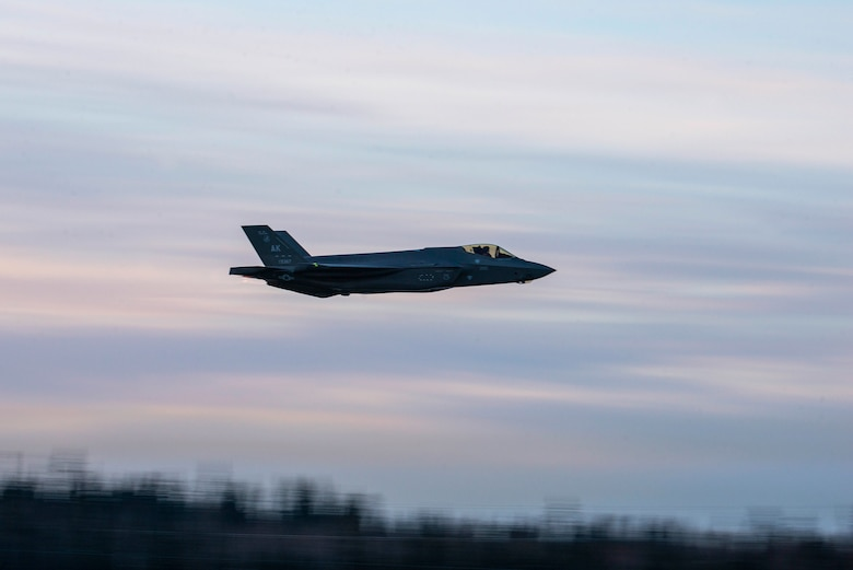 A U.S. Air Force F-35A Lightning II assigned to the 354th Fighter Wing flies over Eielson Air Force Base, Alaska, Dec. 18, 2020.