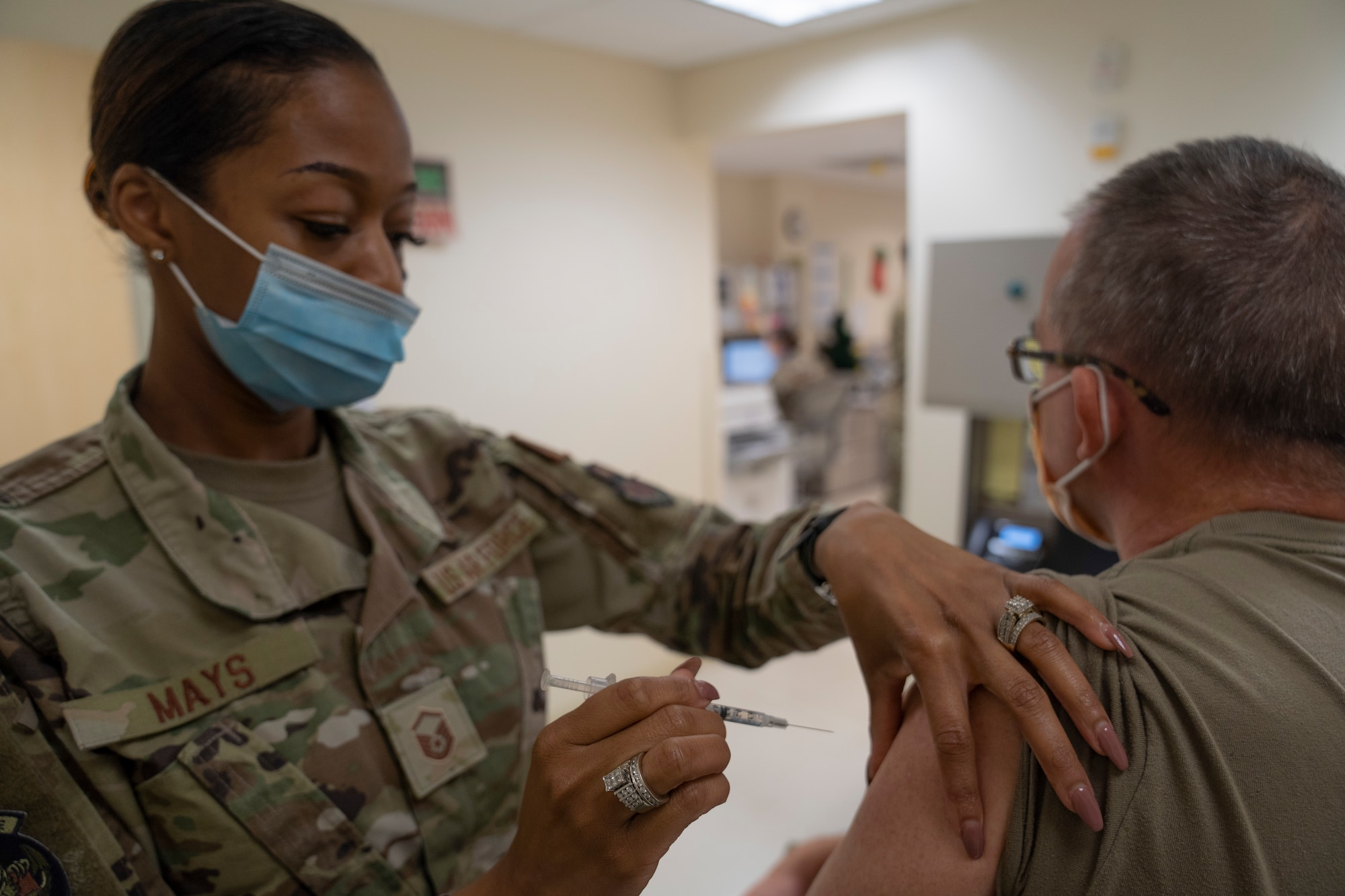 Master Sgt. La'Kisha Mays, 81st Healthcare Operations Squadron medical specialties flight chief, administers the COVID-19 vaccine to Col. Wayne Latack, 81st Medical Group internal medicine residency program director, inside the Keesler Medical Center at Keesler Air Force Base, Miss., Dec. 21, 2020. Members of the 81st MDG administered the COVID-19 vaccine to Keesler first responders and members of the Armed Forces Retirement Home in Gulfport, Miss. (U.S. Air Force photo by Airman 1st Class Kimberly L. Mueller)