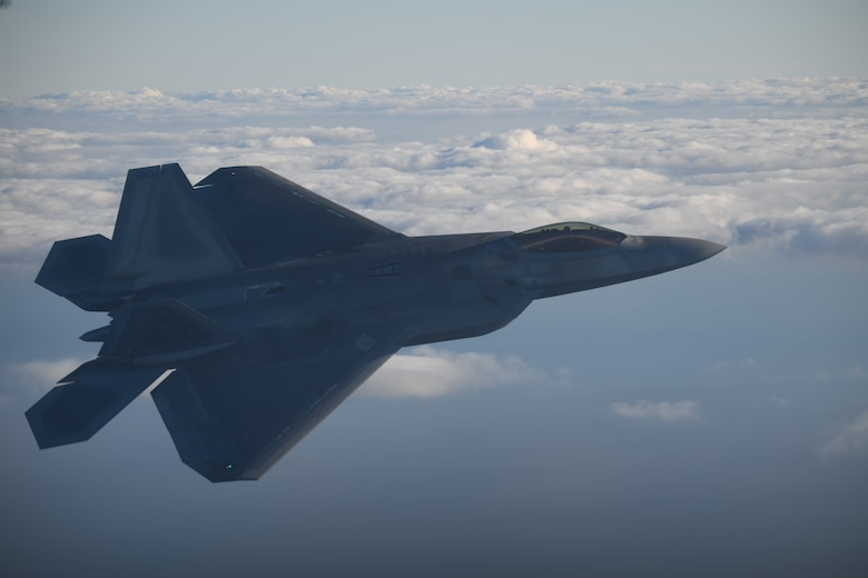 An  F-22 Raptor with the 325th Fighter Wing, Tyndall Air Force Base, Fla.  flies over the Gulf of Mexico, Dec. 10, 2020. Tyndall AFB is one of the few Air Force bases with direct access to the area, making it the perfect host for large-scale exercises and training missions. (U.S. Air Force photo by Airman 1st Class Tiffany Price)