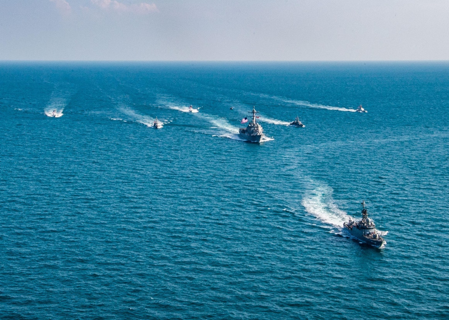 The Royal Saudi Naval Force corvette HMS Badr (612), front to back, the guided-missile destroyer USS Winston S. Churchill (DDG 81), center, Navy patrol coastal ships USS Squall (PC 7), USS Firebolt (PC 10), Coast Guard patrol boats USCGC Monomoy (WPB 1326), USCGC Maui (WPB 1304) and USCGC Wrangell (WPB 1332) transit the Arabian Gulf during the joint and combined air operations in support of maritime surface warfare (AOMSW) exercise in the Arabian Gulf, Dec. 17. Combined integration operations between joint U.S. forces are regularly held to maintain interoperability and the capability to counter threats posed in the maritime domain, ensuring freedom of navigation and free flow of commerce throughout the region's heavily trafficked waterways.