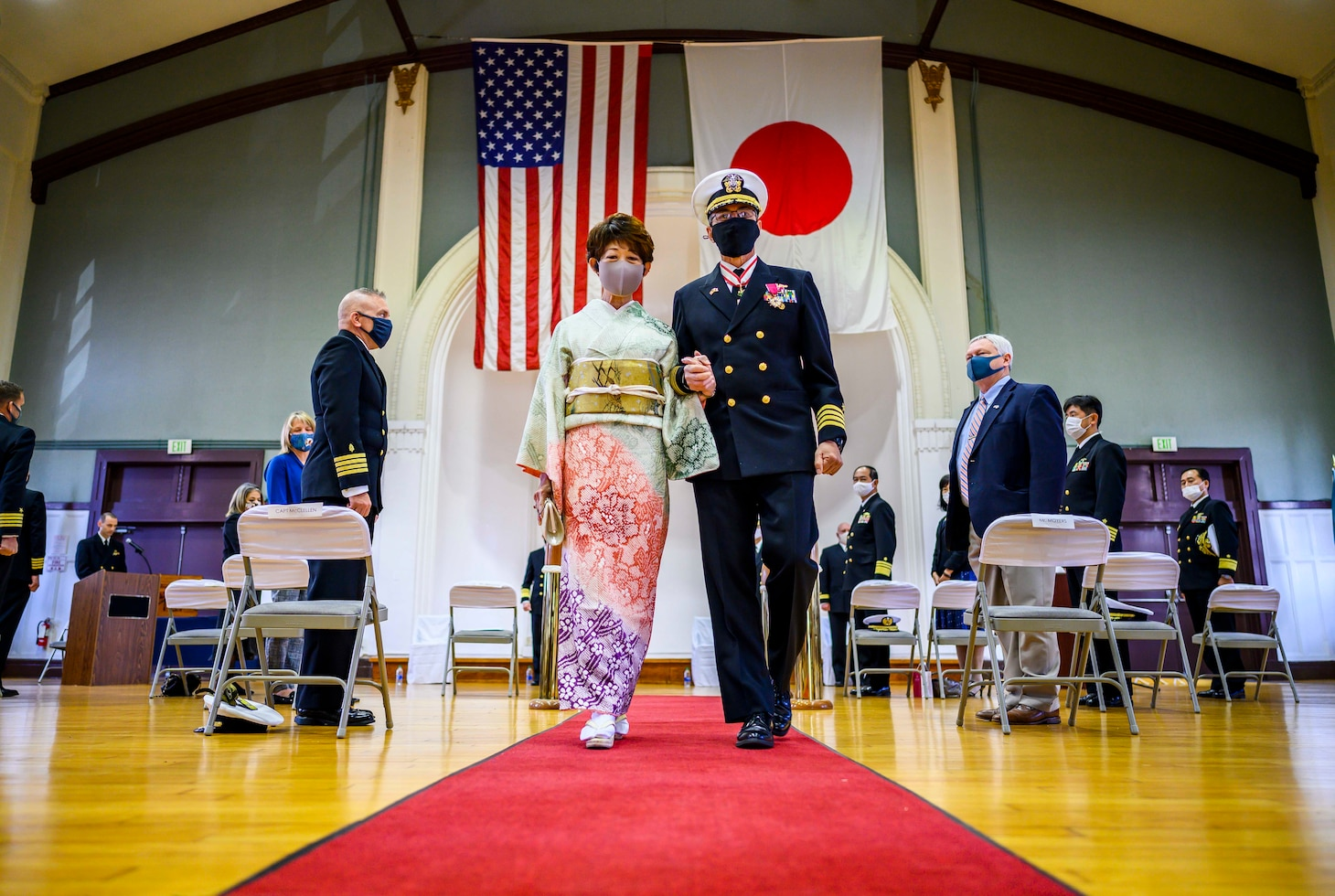YOKOSUKA, Japan (Nov. 30, 2020) Capt. Harry Ganteaume, Submarine Group 7's former Chief of Staff and Operations Officer, and his wife, Sumiko, are rung ashore during his retirement ceremony at Commander Fleet Activities Yokosuka. (U.S. Navy photo by Mass Communication Specialist 2nd Class Taylor DiMartino)