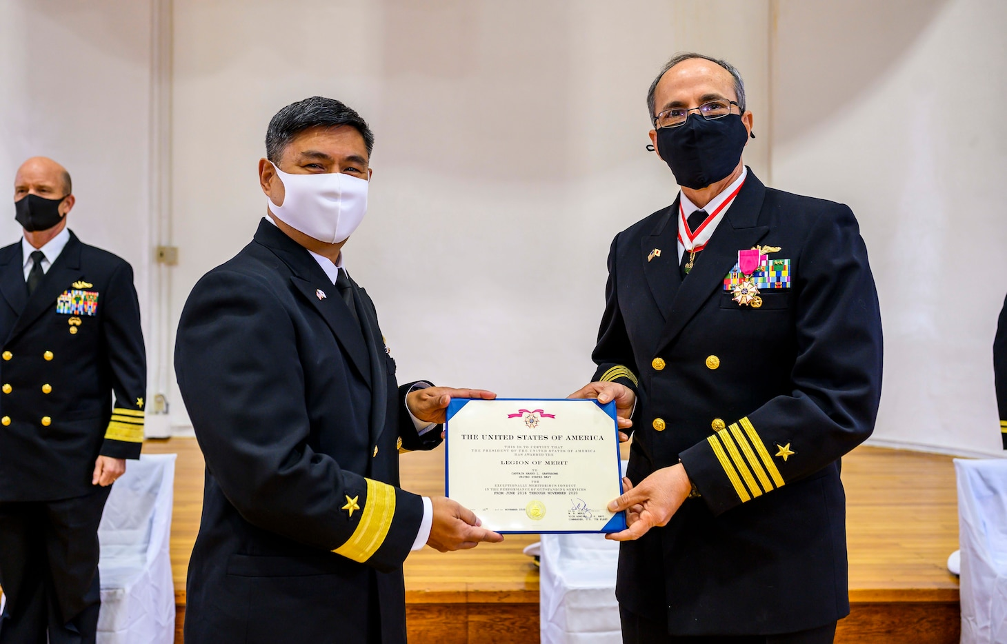 YOKOSUKA, Japan (Nov. 30, 2020) Rear Adm. Butch Dollaga, Commander, Submarine Group 7, awards Capt. Harry Ganteaume, the Group's former Chief of Staff, with the Legion of Merit during his retirement ceremony aboard Commander Fleet Activities Yokosuka. (U.S. Navy photo by Mass Communication Specialist 2nd Class Taylor DiMartino)