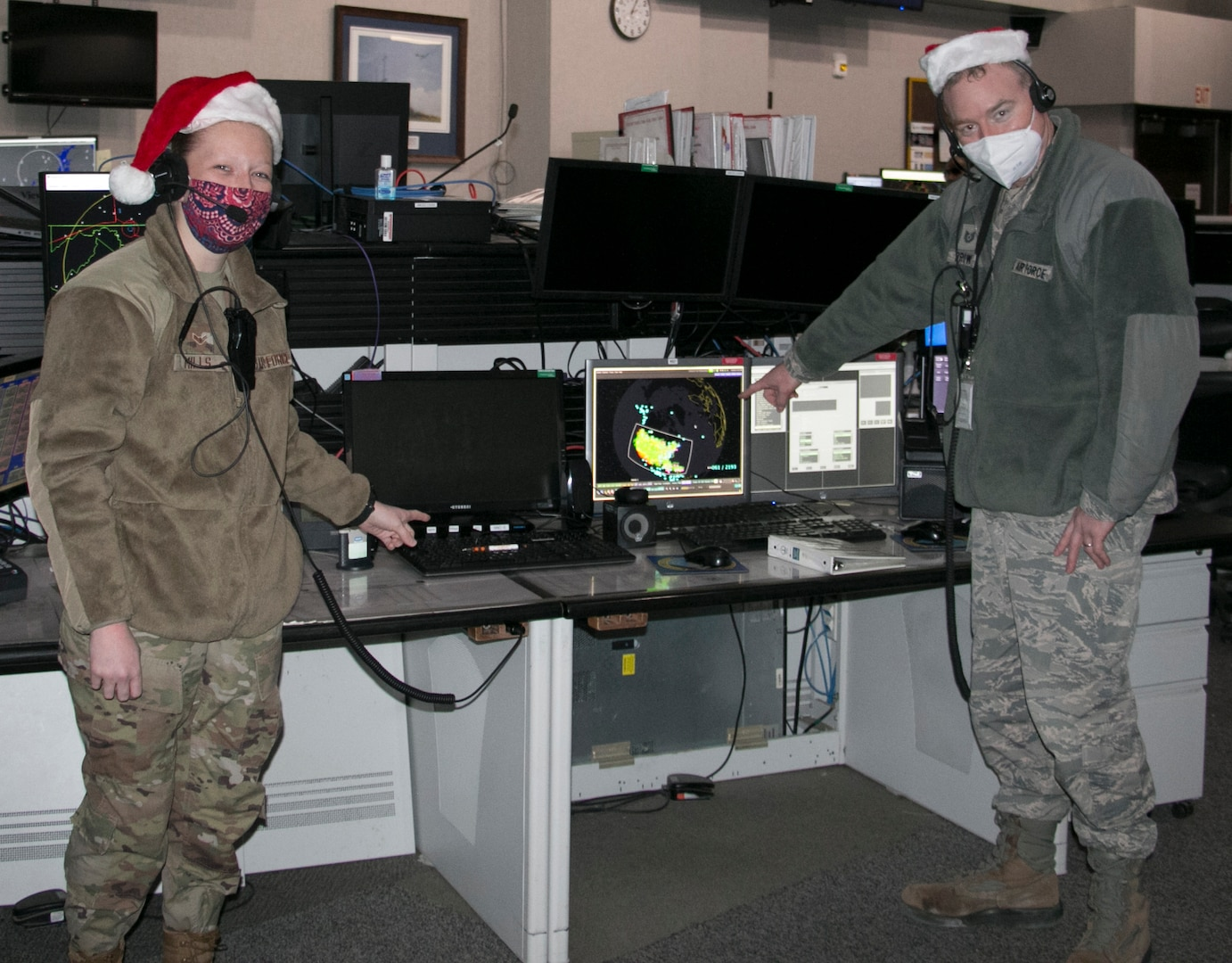 New York Air National Guard Airman 1st Class Megan Mills, left, and Tech. Sgt. Kriston Brown participate in a Santa tracking exercise at the Eastern Air Defense Sector on Dec. 16, 2020. Mills and Brown were prepping for Christmas Eve, when EADS will support the North American Aerospace Defense Command's (NORAD) Santa tracking operation. Tracking operations start at 4 a.m. EST on Dec. 24 on the www.noradsanta.org website. At 6 a.m. EST, children and parents can call toll-free to inquire about Santa at 1-877-Hi-NORAD (1-877-446-6723).
