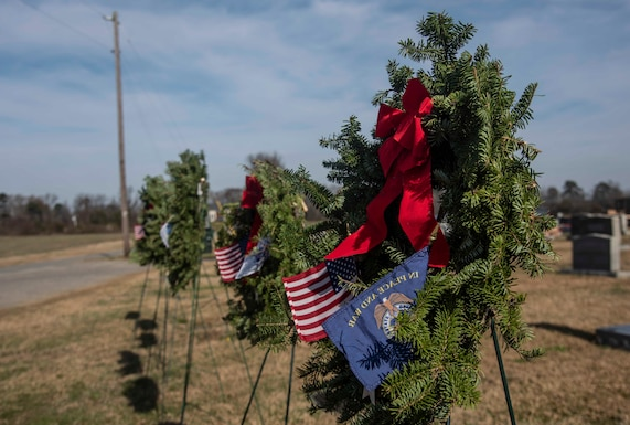 Airmen and local community members gather for the Wreaths Across America event