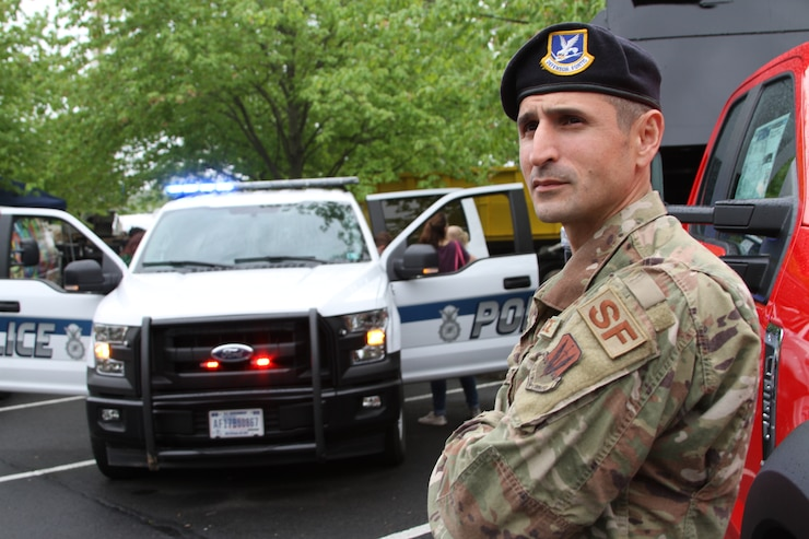 A service member in umiform with the 111th Attack Wing's Security Forces Squadron, displays his military police vehicle at a Touch-a-Truck event in Doylestown, Pennsylvania, May 4, 2019.
