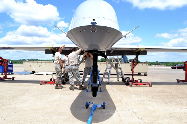 An aircraft maintenance team from the 174th Attack Wing out of Syracuse, N.Y., assemble a static display General Atomics MQ-9 Reaper on June 6, 2014 at Horsham Air Guard Station.