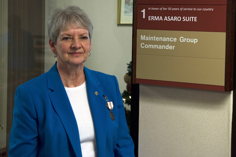 Erma Asaro, an administrative executive assistant for the 437th Maintenance Group, poses with her suite dedication plaque during her retirement ceremony, at Joint Base Charleston S.C., Dec. 18, 2020. Asaro served 51 years of outstanding service and was instrumental in the success of numerous large formation exercises, humanitarian relief operations and real world contingencies.