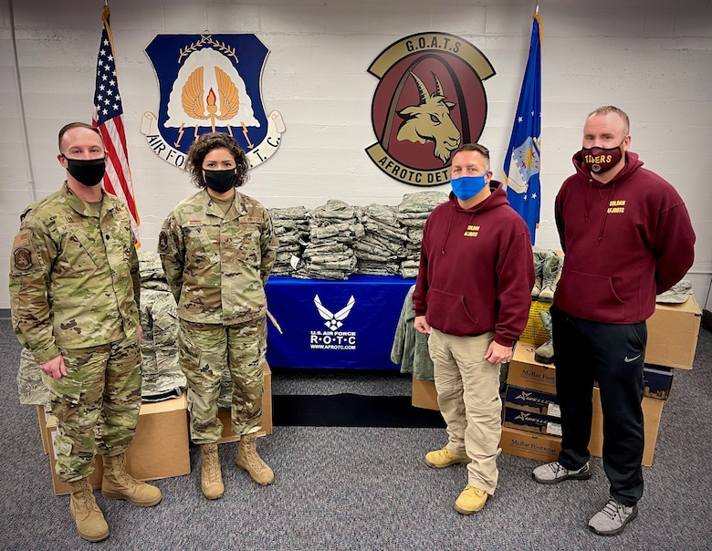 Leadership from Air Force ROTC Detachment 207 donate a supply of Airman Battle Uniform sets to the Air Force Junior ROTC detachment at Soldan International Studies High School at Saint Louis University, St. Louis, Missouri Dec. 18, 2020. The uniforms -- which include blouses, pants, boots, hats, all-weather coats, and accessories -- will be used to outfit some of the more than 150 high school students in the AFJROTC detachment.