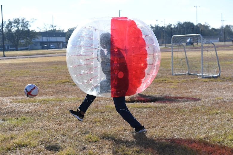 An Airman from the 81st Training Group participates in a bubble ball soccer tournament at Keesler Air Force Base, Mississippi, Dec. 21, 2020. The 81st TRG held various events for Airmen to participate in throughout the holidays, to include ice skating, inflatables, a scavenger hunt and a bubble ball soccer tournament. (U.S. Air Force photo by Kemberly Groue)