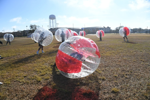 Airmen from the 81st Training Group participate in a bubble ball soccer tournament at Keesler Air Force Base, Mississippi, Dec. 21, 2020. The 81st TRG held various events for Airmen to participate in throughout the holidays, to include ice skating, inflatables, a scavenger hunt and a bubble ball soccer tournament. (U.S. Air Force photo by Kemberly Groue)
