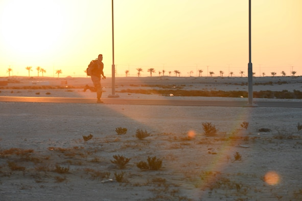 U.S. Army Private 1st Class Isaac Vieau, an ammunition supply specialist, 395th Ordnance Company, deployed to Al Udeid Air Base, Qatar, rucks through sunrise Dec. 5, 2020, while participating in the traditional 30-kilometer (18.6-mile) Norwegian foot march event. The tradition began in 1915, 10 years after Norway gained its independence from Sweden and has become a rite of passage for all Norwegian military members. Vieau was one of nearly 120 coalition members, including Americans, Australians, New Zealanders, British and Canadians who participated in the march under the supervision of Norwegian armed forces Capt. Magne Rambo, deployed to Al Udeid AB as part of the U.S. Central Command Partner Integration Enterprise. (U.S. Air Force photo by Staff Sgt. Kayla White)
