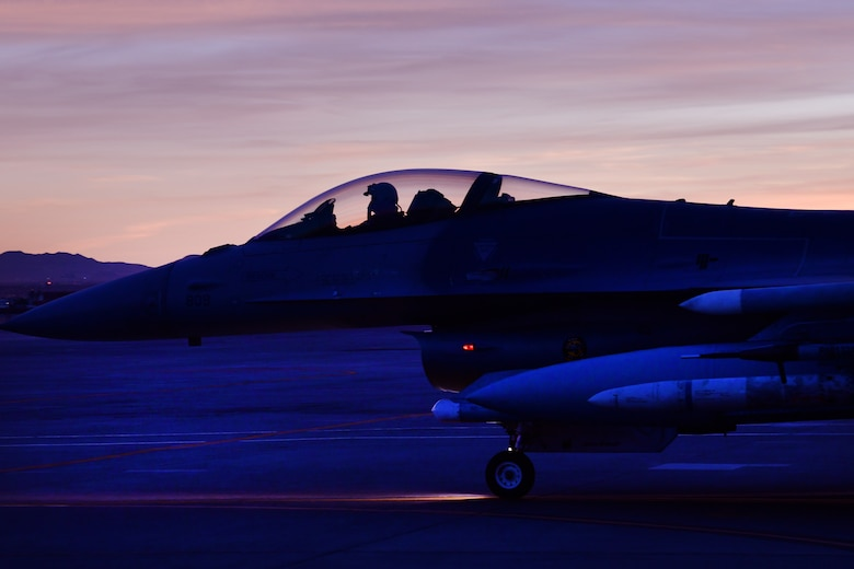 Lt. Col. Stephen Graham, 84th TES electronic warfare test director, taxis on the flight line as he prepares to conduct Force Development Evaluations of multiple systems on the F-16, Dec. 15, Nellis Air Force Base, Nev. (U.S. Air Force Photo by Major Mike Giaquinto)