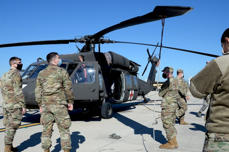 Operation Nightstorm ground crew members familiarize themselves with a UH-60 Black Hawk helicopter in preparation for sling loading cargo Dec. 14, 2020, at Martindale Army Air Field, San Antonio, Texas. (U.S. Air Force photo by Tech. Sgt. Samantha Mathison)