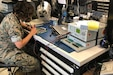 A U.S. Marine operates the legacy Circuit Card Assembly Test Station, aboard Camp Lejeune, North Carolina, Oct. 30.