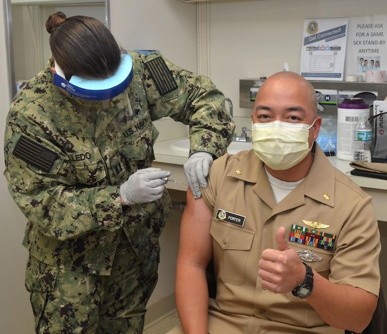 Lt. Cmdr. Ian Porter, an aviation medicine physician, receives COVID-19 vaccine at Naval Hospital Jacksonville on Dec. 18.
