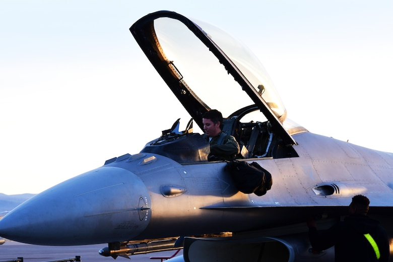 Maj. Christopher Arnott, 84th TES F-16 operational test and evaluation instructor pilot, prepares for flight to conduct Force Development Evaluations of multiple systems on the F-16, Dec. 15, Nellis Air Force Base, Nev. (U.S. Air Force Photo by Staff Sgt. Paige Yenke)