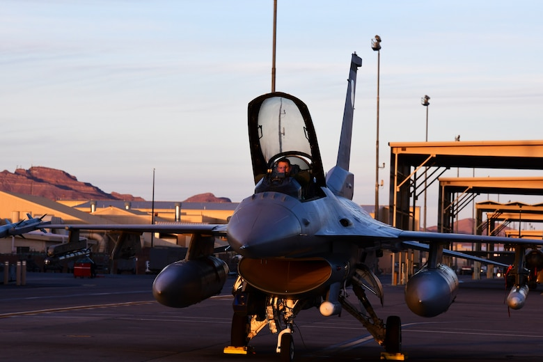 Lt. Col. Stephen Graham, 84th TES electronic warfare test director, prepares for flight to conduct Force Development Evaluations of multiple systems on the F-16, Dec. 15, Nellis Air Force Base, Nev. (U.S. Air Force Photo by Staff Sgt. Paige Yenke)