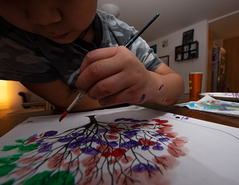 Photo of boy painting
