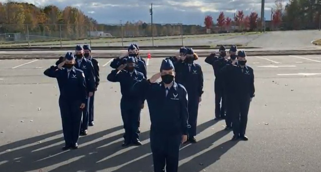 A Clover High School Air Force Junior Reserve Officer Training Guard drill team render a salute during their competition video recording in Clovis, South Carolina. Participating teams recorded their drill events prior to the submission date, to ensure the competition could take place safely amid the COVID pandemic.